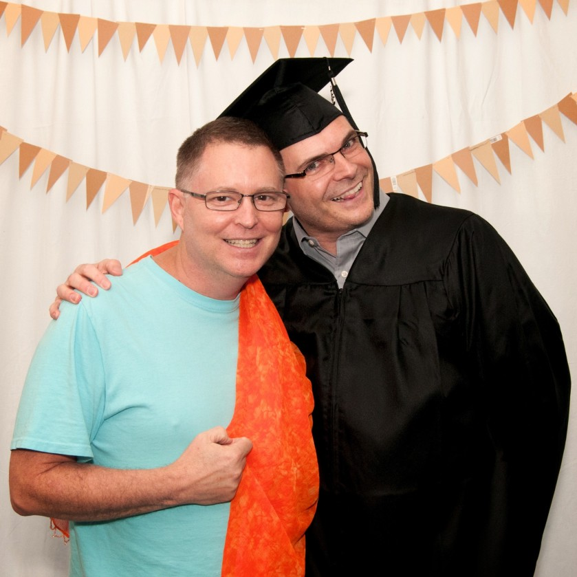 "Andy's wearing an orange pashmina at a ""fun photo"" booth a photographer classmate of ours set up at our hooding ceremony. This was taken before I was hooded."