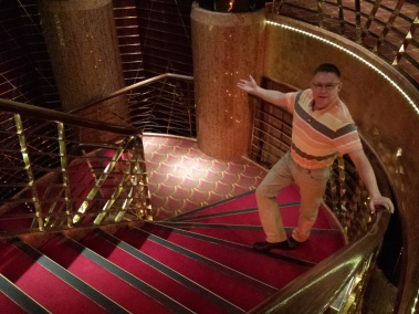Andy on the staircase of the theatre, HAL Veendam