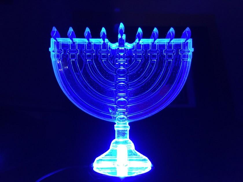 blue-lit Chanukah menorah